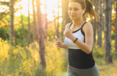 Women wunning with a smartwatch